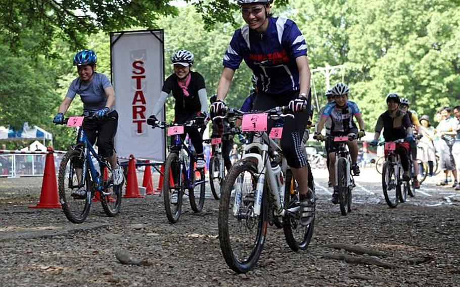 Grant Okubo/Stars and Stripes Riders take off at the start of the 5-kilometer womens division race at the Tour de Tama on Saturday at Tama Hills Recreation Center near Yokota Air Base, Japan.