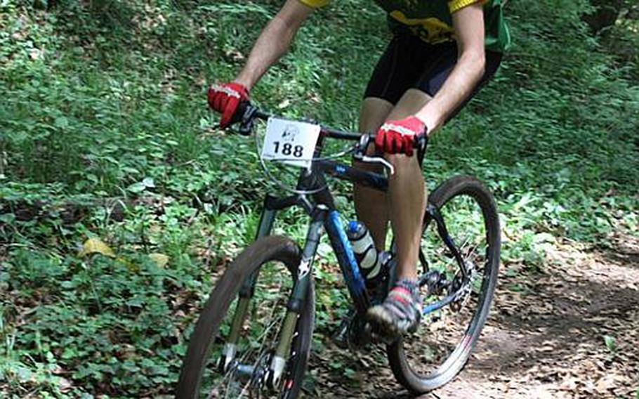 Grant Okubo/Stars and Stripes Michael Rice navigates the trail in the 25th Tour de Tama on Saturday at Tama Hills Recreation Center.