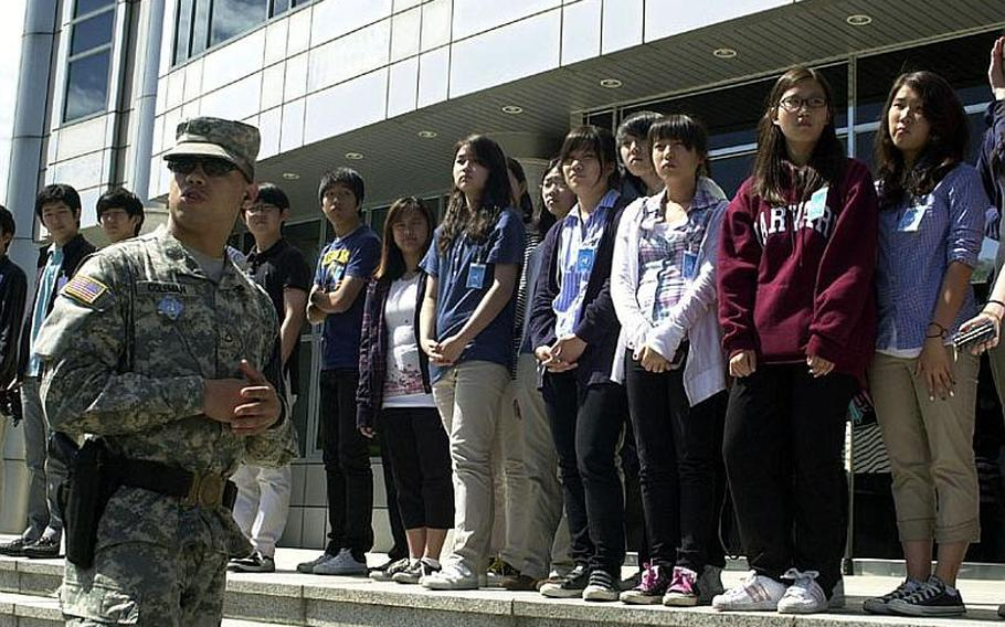 A United Nations Command security escort briefs a visiting group of teenagers Wednesday at the Joint Security Area of the Demilitarized Zone of Korea. Tours appeared to go on as usual despite rising tensions between North Korea and South Korea.