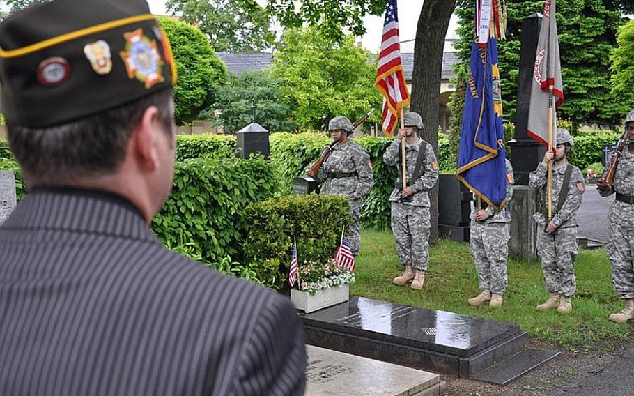 Gregory Obert looks on during a ceremony Sunday at the Bamberg city cemetery to honor the 20 U.S. servicemembers who are buried there.