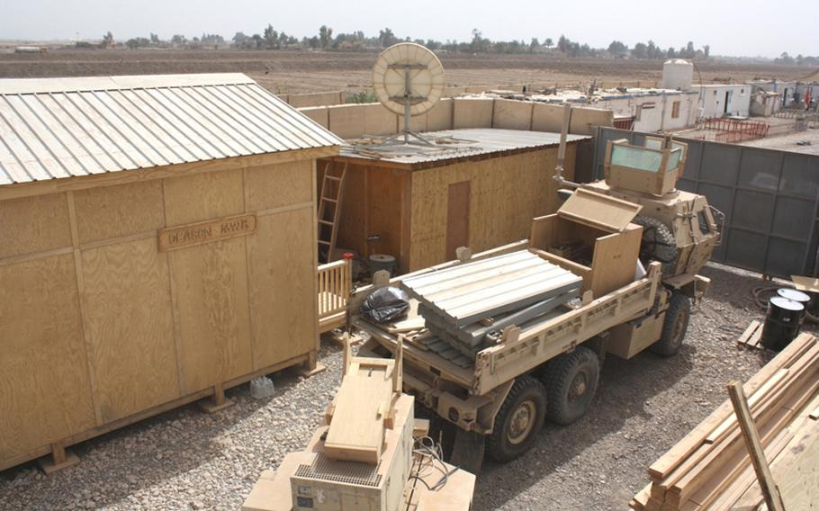With their supplies loaded up, soldiers with the 1434th Engineer Company finish up the construction of a building at Joint Security Station Deason, south of Baghdad, on March 10. The building was to offer space for religious services and for soldiers to use the telephones and Internet.