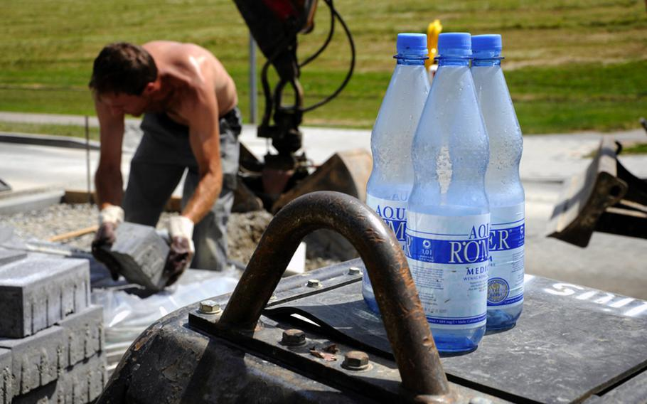 Henrique Barbosa, who has been working on the roads of Robinson Barracks in Stuttgart, Germany, said Friday he doubled the amount of water he drinks to avoid dehydration during the hot weather. Temperatures are expected to be in the 90s for many U.S. military communities in Europe this weekend.