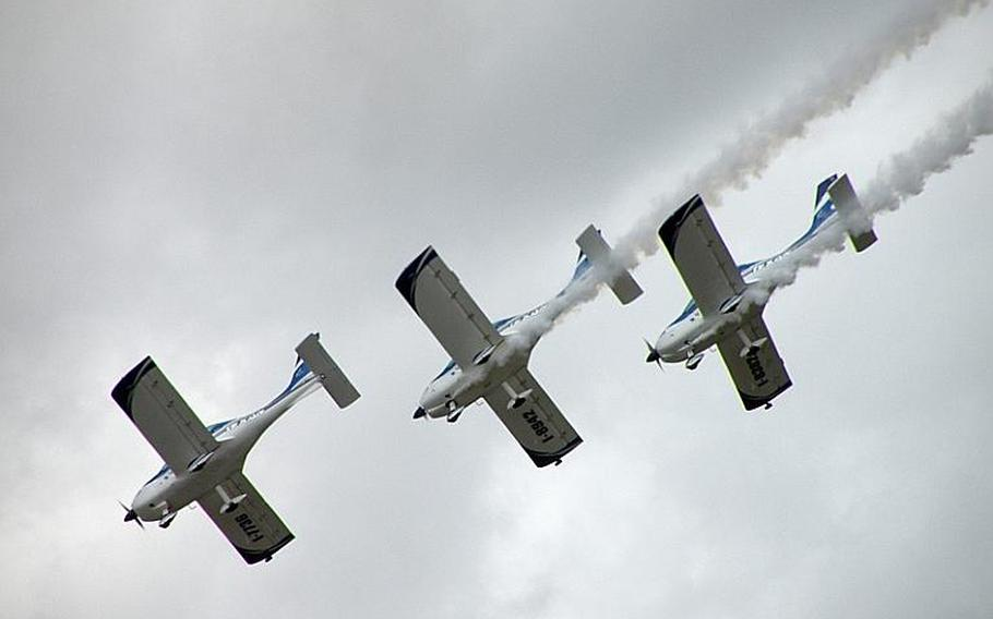 Disabled pilots from the Italian We Fly team maneuver their Texan 550 LSA aircraft over the tens of thousands of spectators in attendance at the 25th annual Royal International Air Tattoo at RAF Fairford, England. The light-sport aircraft are designed to be easy to fly.