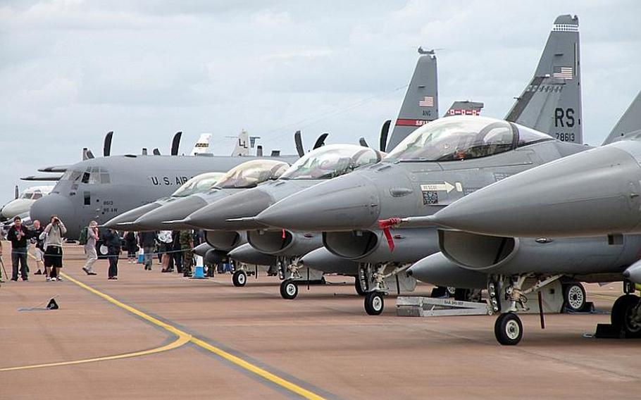 A row of F-16AM Fighting Falcons from the Royal Netherlands Air Force are on display at the Royal International Air Tattoo at RAF Fairford, England. An estimated 155,000 people will visit the air show over the weekend where about 300 aircraft are on display either in the air or on the ground.    David Hodge/Stars and Stripes
