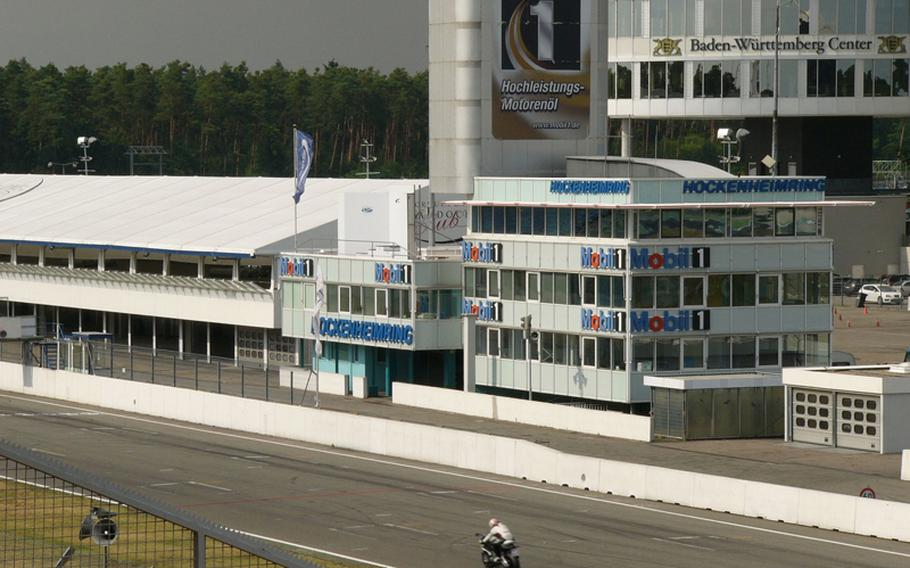 A lone biker tests his machine on Germany's Hockenheimring earlier this month. The track's 'Tourist-Rides' program permits evening visitors to test their own cars and motorcycles, and skills, on the track.