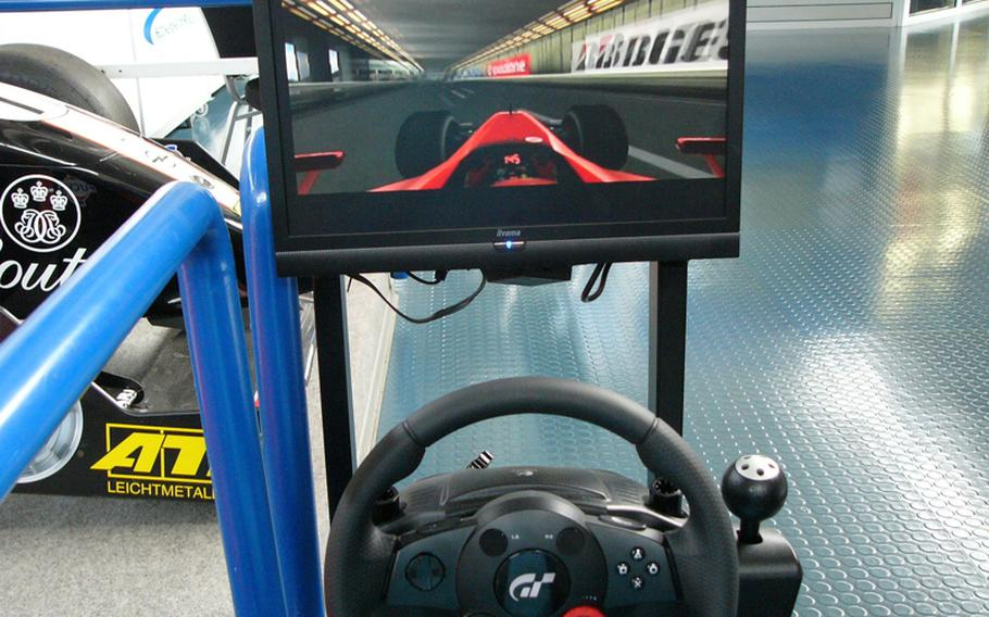 A racer enters the tunnel at Monte Carlo on one of four Formula 1 driving simulators available free of charge at the Hockenheimring Motor-Sport-Museum.