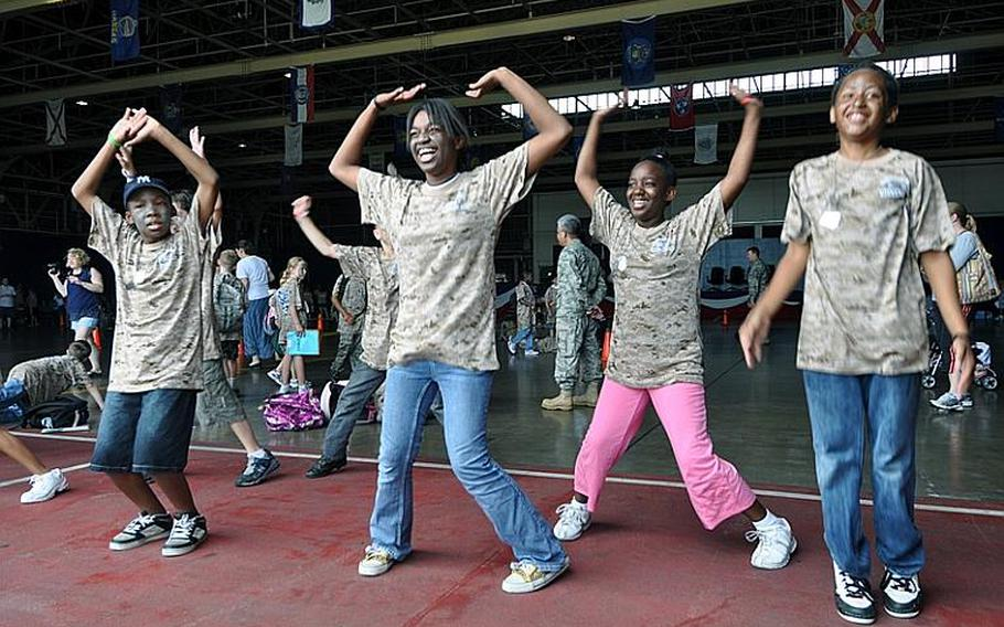 Kids perform jumping jacks while undergoing physical fitness training during Saturday's Operation CODE at Misawa Air Base, Japan.