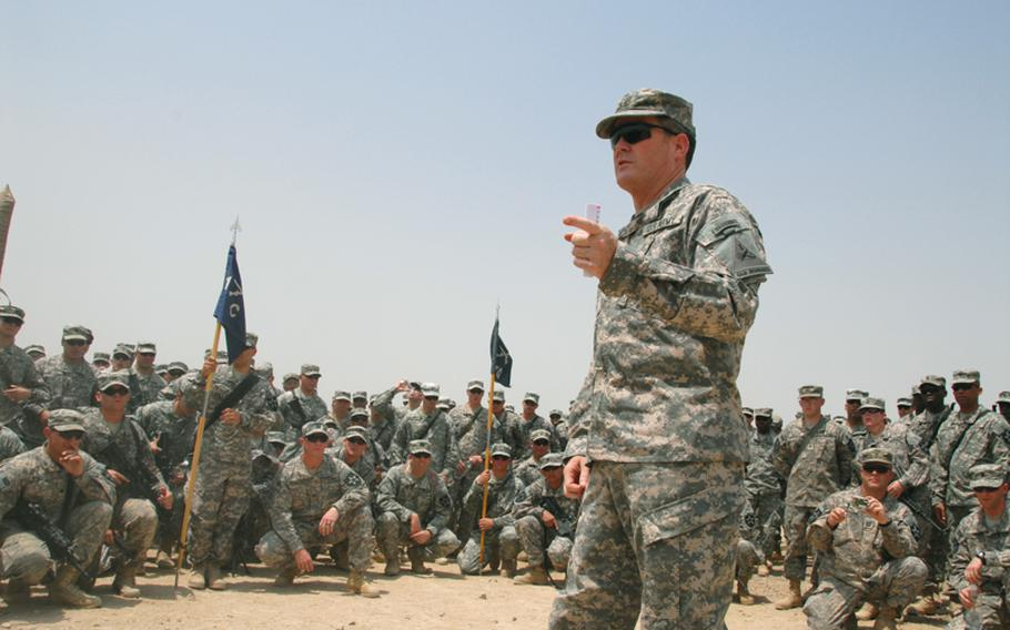 Maj. Gen. Terry Wolff, commander of U.S. Division - Center, talks to members of the 1st Battalion, 38th Infantry Regiment, 4th Stryker Brigade Combat Team during an awards ceremony Wednesday as the brigade prepares to go home to Fort Lewis, Wash.