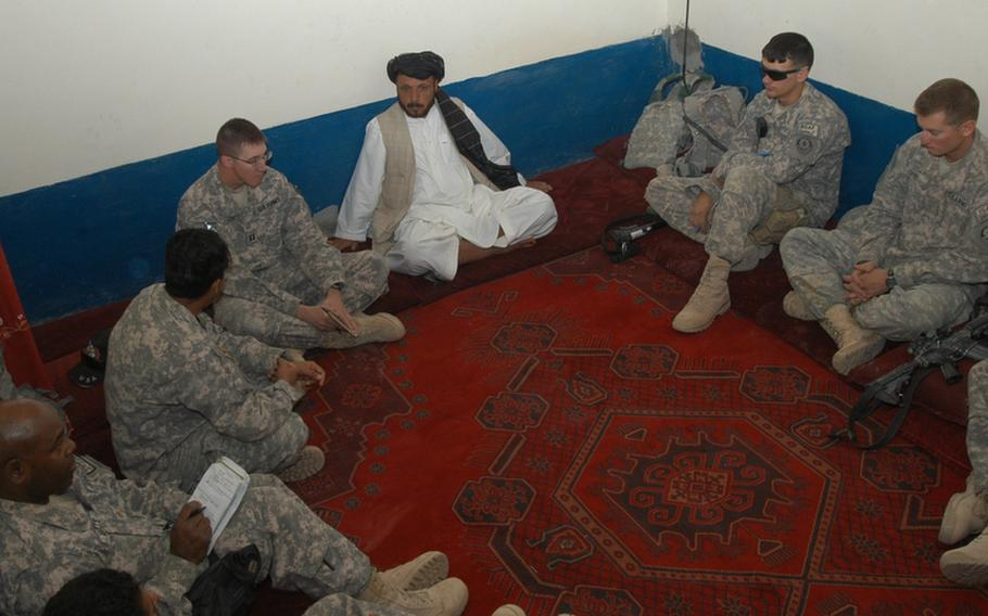 U.S. soldiers meet with Sahib Jan, an Afghan Highway Police commander and the most powerful man in Robat, a village in southern Afghanistan. Jan asked for more fuel for this patrols and roadside checkpoints. Soldiers said they would be bringing winter coats and other cold-weather gear for Jan's men, but stressed that the Afghans have to do a better job of tracking such things because new coats will not be handed out every year.
