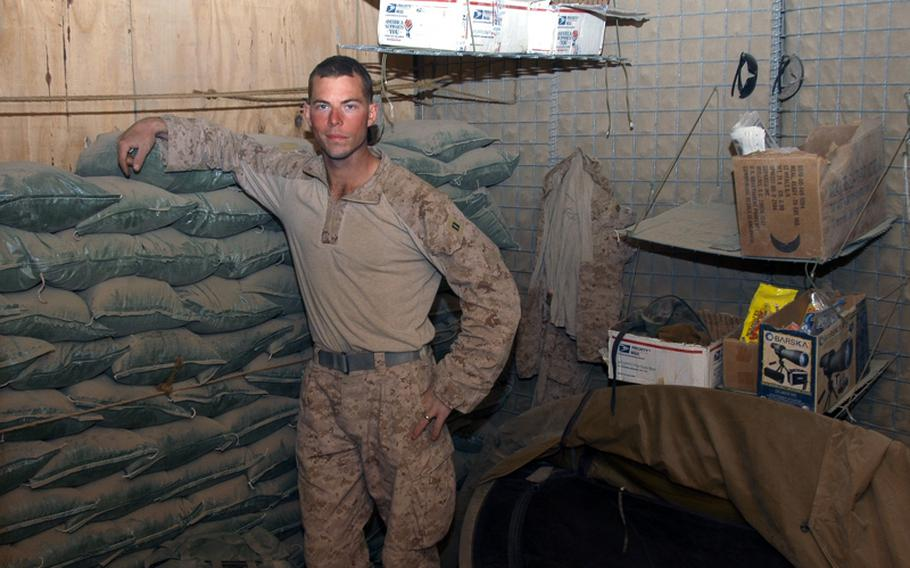 Capt. Nicholas Schmitz, 1st Platoon commander for the 2nd Battalion, 1st Marines' Echo Company, stands recently in the middle of his sleeping area at Patrol Base Hernandez in the southern Garmsir district of Afghanistan. Schmitz, a Rhodes Scholar with a master's from Oxford University, said he enjoys the camping lifestyle that comes along with his job.