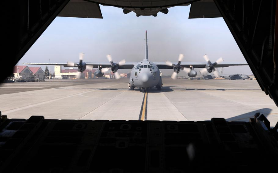 A C-130 out of Yokota Air Base, Japan, prepares for takeoff on Dec. 6, 2010. C-130s out of Yokota were flying over the skies of Japan as part of Keen Sword, a U.S.-Japan training exercise.