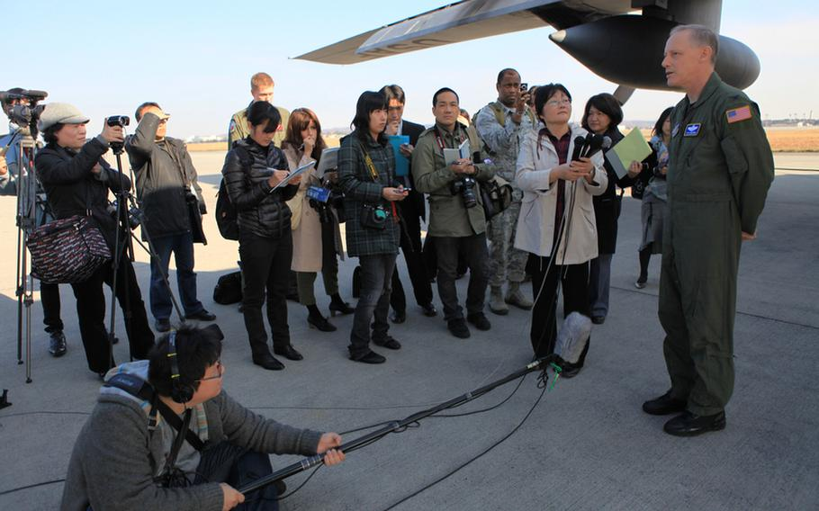 Col. Otto Feather, 374th Airlift Wing Commander, speaks with reporters Monday before Keen Sword, a U.S.-Japan training exercise, which flew over parts of Japan and over the Sea of Japan.