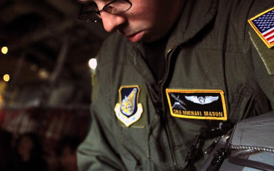 Senior Airman Michael Mason, 374th Airlift Wing, makes some last-minute checks inside a C-130 before it takes off to participate in Keen Sword, a U.S.-Japan training exercise over Japan.