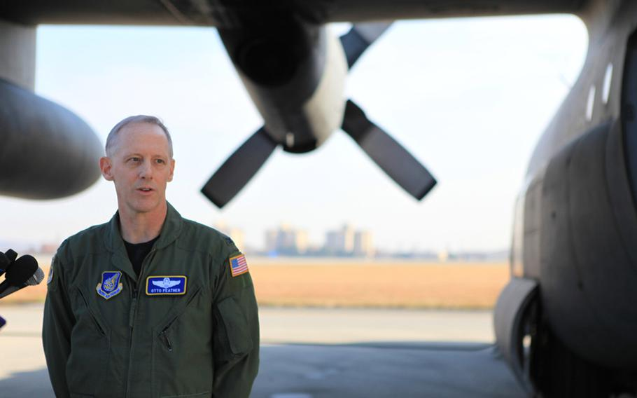 Col. Otto Feather, 374th Airlift Wing Commander, speaks with reporters before C-130s take off to participate in Keen Sword, a U.S.-Japan training exercise, which flew over parts of Japan and over the Sea of Japan.