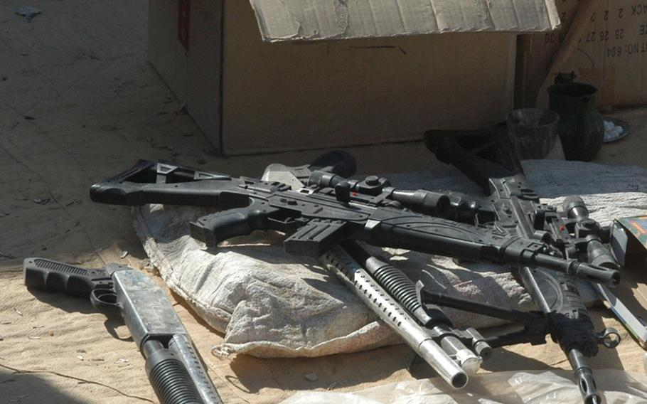 U.S. Marines patrolling through the Safar Bazaar in Garmsir District in Afghanistan recently came upon a merchant selling these realistic-looking toy assault rifles and shotguns.