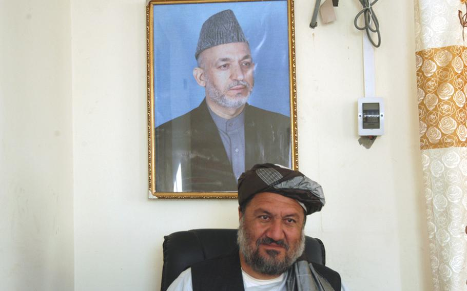 Arghandab District Governor Haji Shah Mohammad sits at his desk in southern Afghanistan. Residents routinely fill the hallways outside Mohammad's district center office looking for him to solve their problems.