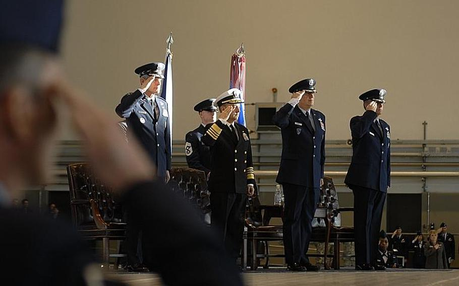 The four-stars salute, from l-r: Gen. Norton Schwartz, U.S. Air Force chief of staff; Adm. James Stavridis, U.S. European Command commander; Gen. Roger Brady, outgoing U.S. Air Forces in Europe commander; and Gen. Mark A. Welsh III, the new USAFE commander. Welsh took over leadership of USAFE at a change-of-command ceremony Monday at Ramstein Air Base, Germany.