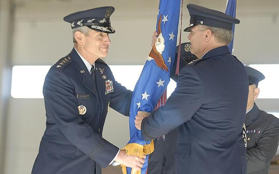 Gen. Mark A. Welsh III, right, accepts the U.S. Air Forces in Europe flag from Air Force Chief of Staff Gen. Norton Schwartz during a USAFE change-of-command ceremony Monday at Ramstein Air Base, Germany. Welsh replaces Gen. Roger Brady as the new USAFE commander.