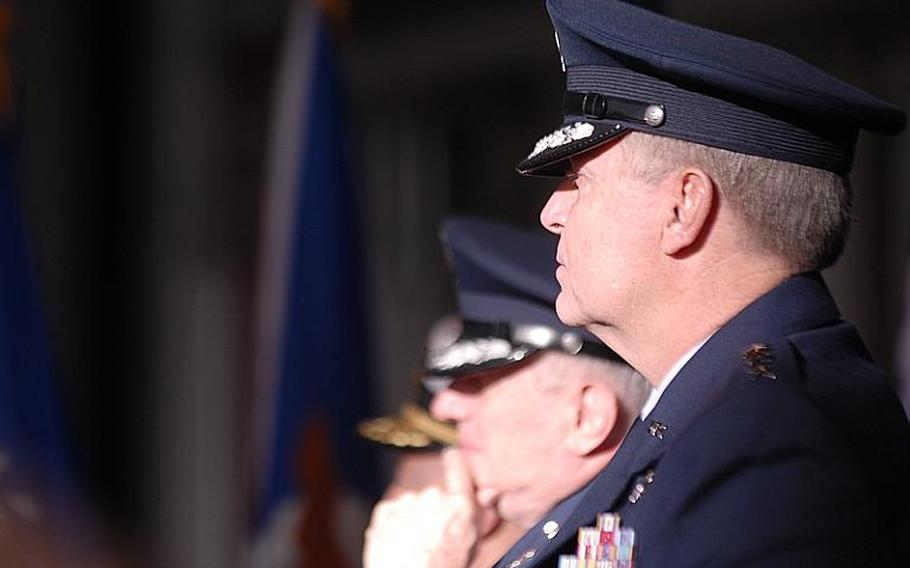 New U.S. Air Forces in Europe Commander, Gen. Mark A. Welsh III, foreground, sat next to his predecessor, Gen.Roger Brady, during a USAFE change-of-command ceremony Monday at Ramstein  Air Base, Germany.