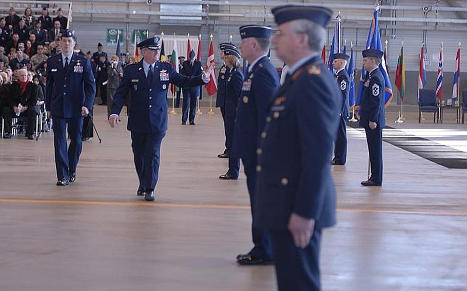 Gen. Roger Brady gives a final farewell to airmen at the U.S. Air Forces in Europe change-of-command ceremony Monday at Ramstein Air Base, Germany. Brady passed the baton to Gen. Mark A. Welsh III, whom most recently served as the Central Intelligence Agency's associate director for military affairs.