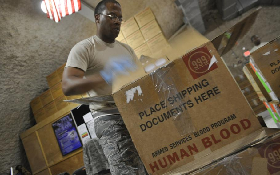 Air Force Tech. Sgt. Anthony Williams, 37, of Bernice, La., inspects a shipment of blood headed to battlefield hospitals in Iraq and Afghanistan. Williams works at the Al Udeid Air Base blood center outside of Doha, Qatar, which processes nearly every drop of blood headed to U.S. troops in harm's way.