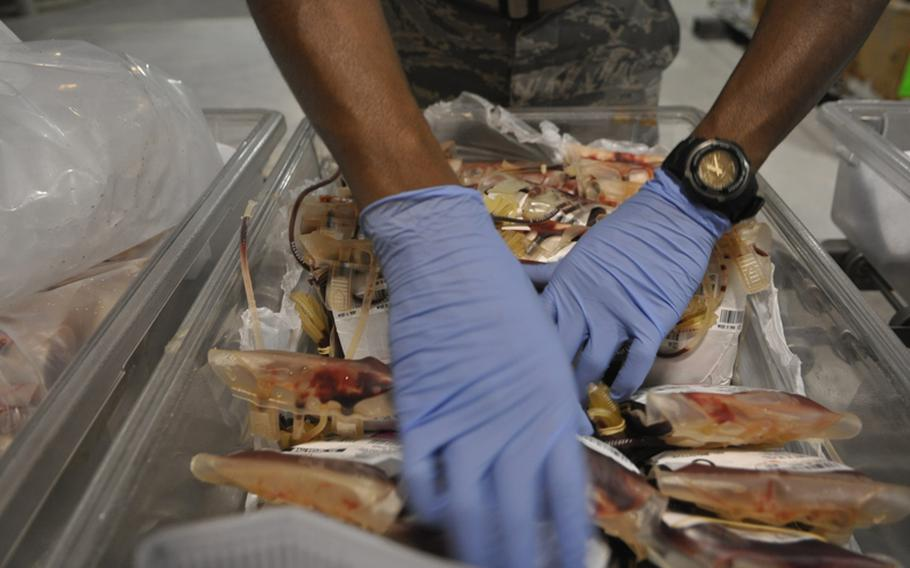 Air Force Senior Airman Kendall Thomas, 23, of Philadelphia, sorts blood destined for battlefield hospitals in Iraq and Afghanistan.