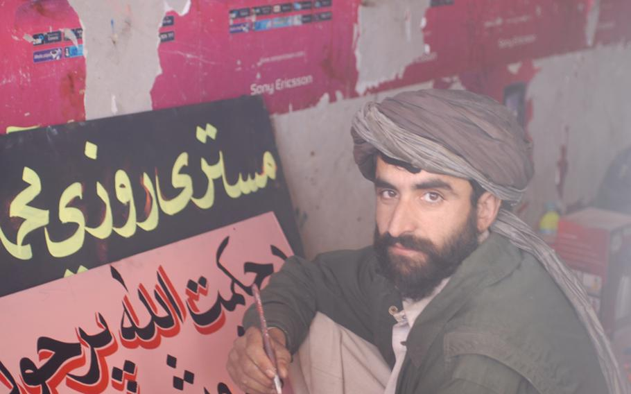 Marines are paying for Marjah shopkeepers in the bazaar to upgrade their shops, which has made Rafillh, a sign painter, a happy man. He said he's earning more than he ever has.