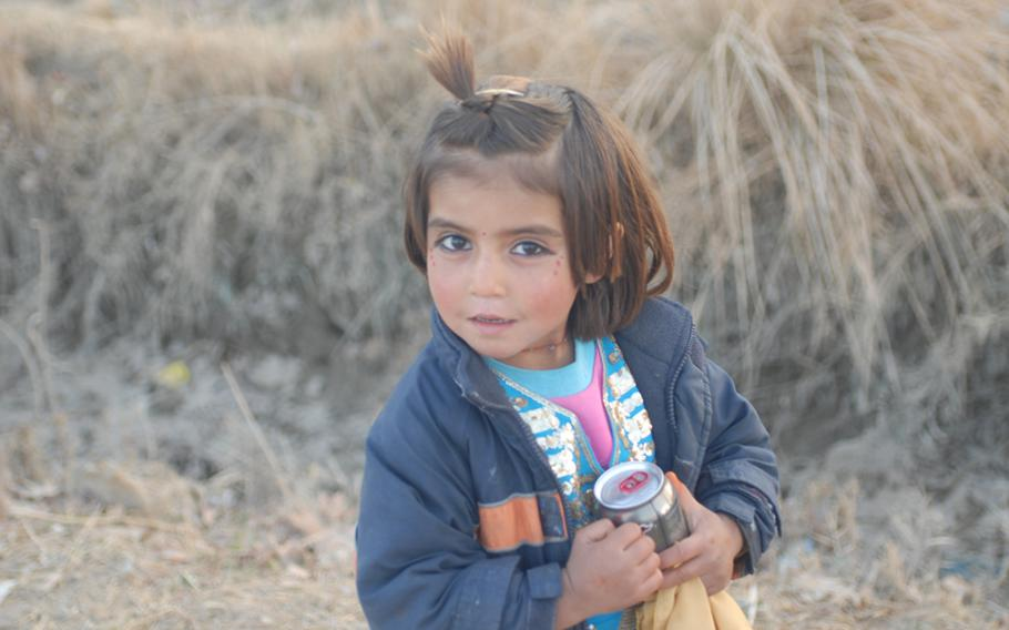 A little girl in Marjah agrees to have her photo taken. Schools might open for a couple of hours a day then close when teachers or children stop showing up.