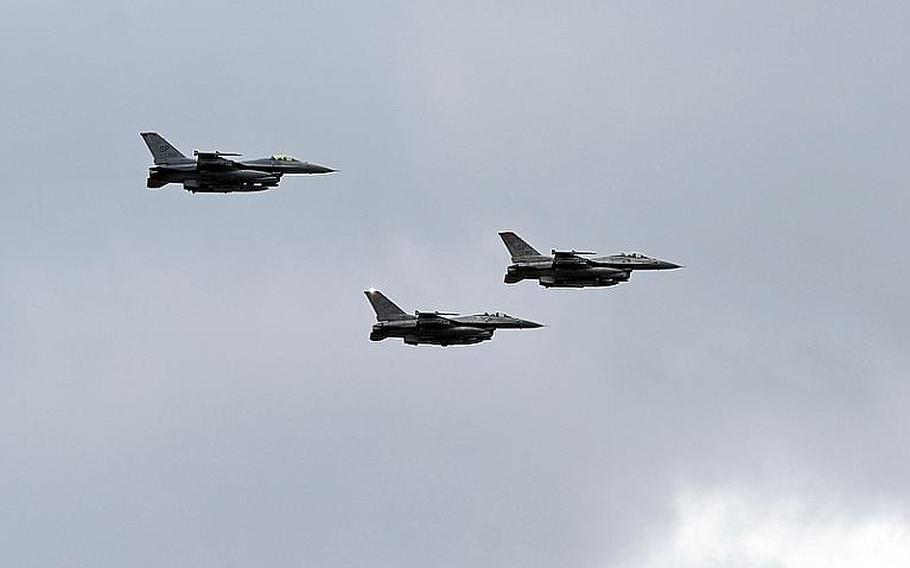 A trio of F-16s from Spangdahlem Air Base, Germany, do a flyby over Ramstein Air Base following the memorial service for  Airman 1st Class Zachary Cuddeback on Thursday. Cuddeback was one of two airmen killed by a gunman at Frankfurt airport last Wednesday.
