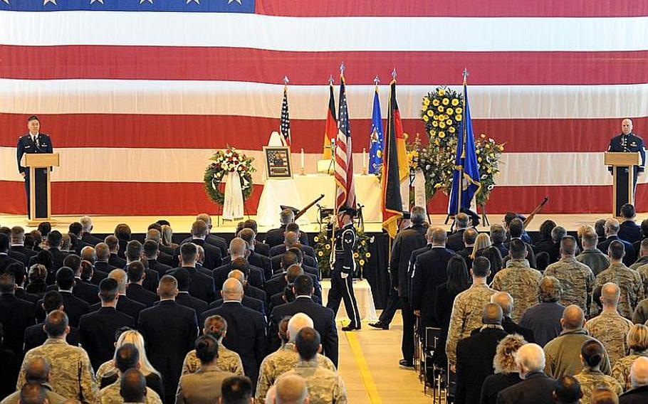The Ramstein Air Base honor guard post the colors at the beginning of the memorial service for Airman 1st Class Zachary Cuddeback on Thursday morning. Cuddeback was on of two airmen killed by a gunman at Frankfurt airport, last Wednesday.
