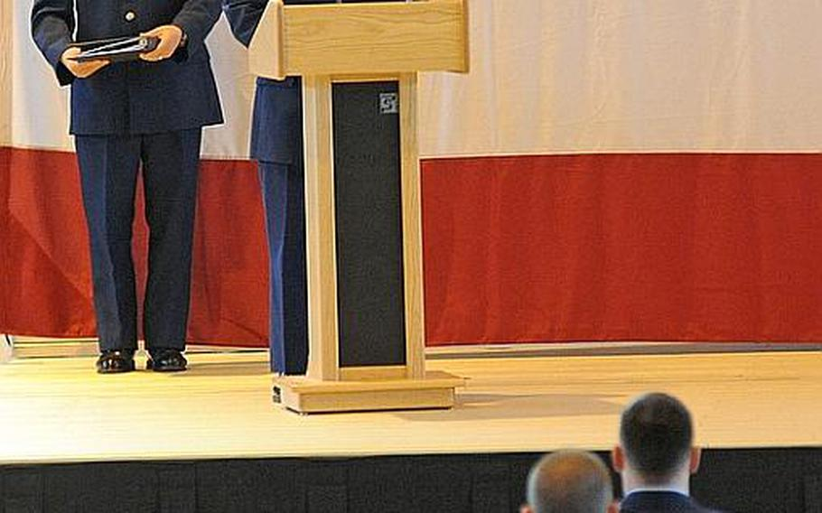 Master Sgt. Brian Fitzsimmons takes roll call at the conclusion of the memorial service for  Airman 1st Class Zachary Cuddeback at Ramstein Air Base, Germany, on Thursday. Cuddeback was one of two airmen killed by a gunman at Frankfurt airport last Wednesday. At left is Chaplain (Capt.) David Suh presided over the service.