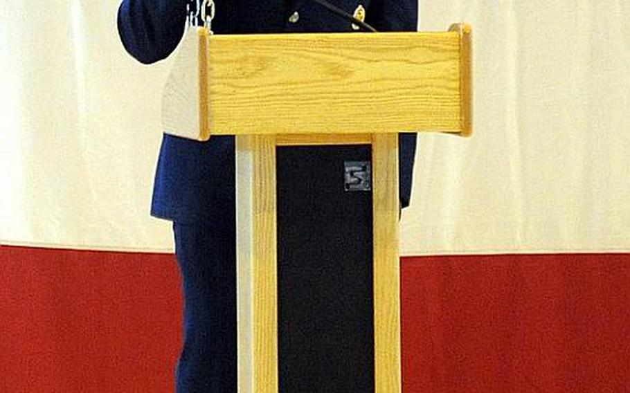 While talking about Airman 1st Class Zachary Cuddeback,  Lt. Col.  Uduak Udoaka, commander of the 86th Vehicle Readiness Squadron, holds the VRS chain, which he said symbolizes the connection between the members of the 86th VRS. A memorial service was held at Ramstein Air Base on Thursday for Cuddeback, one of two airmen killed by a gunman at Frankfurt airport, last Wednesday.