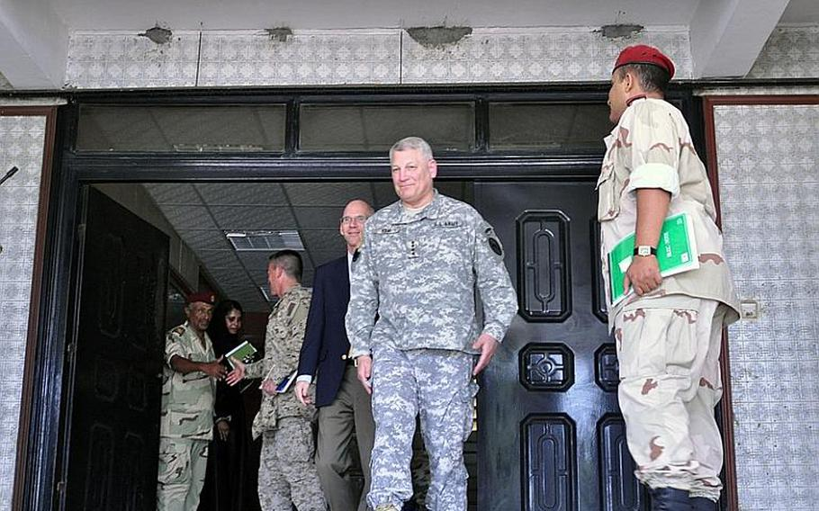 Army Gen. Carter F. Ham, commander of U.S. Africa Command, leaves Djiboutian military headquarters after a meeting with the country's chief of defense. Behind Ham is U.S. Ambassador to Djibouti James C. Swan, who also attended the meeting.  Seth Robbins/Stars and Stripes