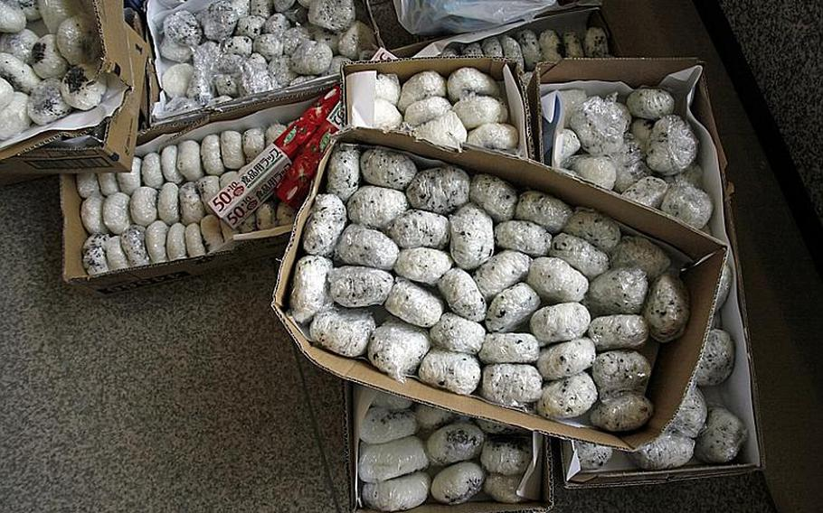 Worker loaded cargo trucks with supplies and food, like these rice balls, bound for evacuation sites throughout the area at the Sendai Prefectural Headquarters  Building, in Sendai City.
