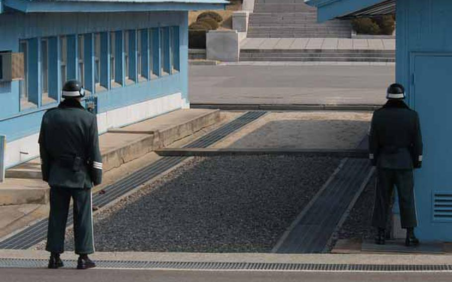 South Korean soldiers stand guard as a tour group is led through the Joint Security Area of Korea's Demilitarized Zone on Wednesday.