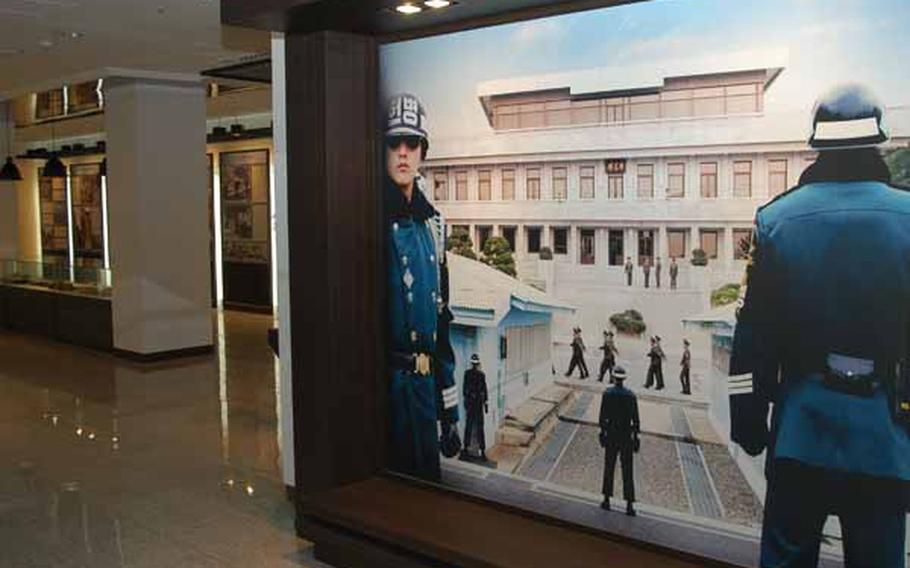 A picture of the Joint Security Area of Korea's Demilitarized Zone greets tourists in the museum area of a new visitor center near the popular tourist destination.