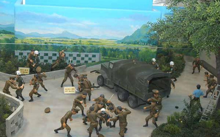 """In a display at the new Joint Security Area Visitor Center at Korea's Demilitarized Zone, figurines depict the Aug. 18, 1976 """"Axe Murder Incident"""" in which two U.S. soldiers were killed and nine other Americans and South Koreans were injured."""
