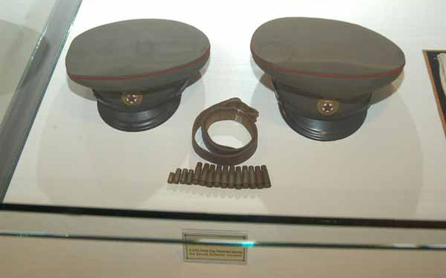 On display at the recently opened Joint Security Area Visitor Center at Korea's Demilitarized Zone are the hats of North Korean soldiers involved a Nov. 23, 1984 incident at the DMZ during which a Soviet citizen tried to defect and three North Korean soldiers and one South Korean soldier were killed in the ensuring firefight. Casings from the rifles and pistols fired that day are also on display.