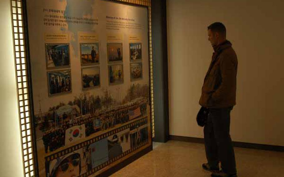 U.S. Army 1st Lt. Brian Baker looks at an exhibit Wednesday in the Joint Security Area Visitor Center at Korea's Demilitarized Zone.