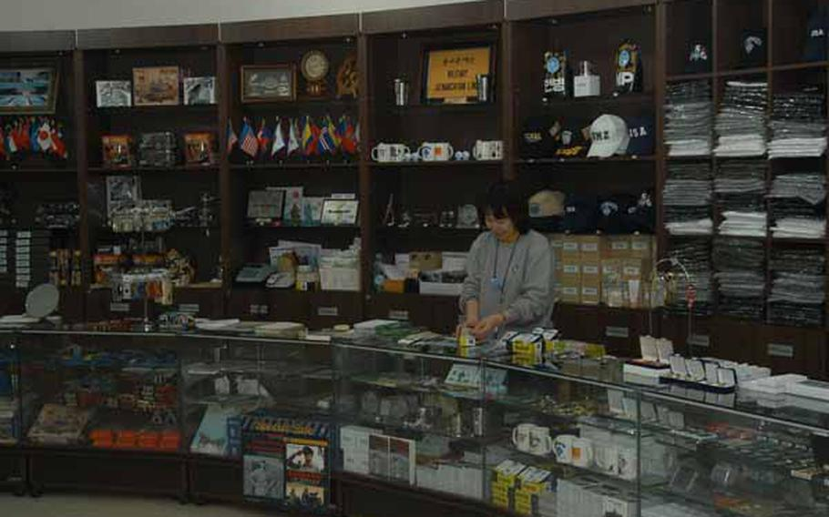 A clerk prepares for the next busload of tourists to arrive Wednesday at the gift shop in the new Joint Security Area Visitor Center at Korea's Demilitarized Zone.