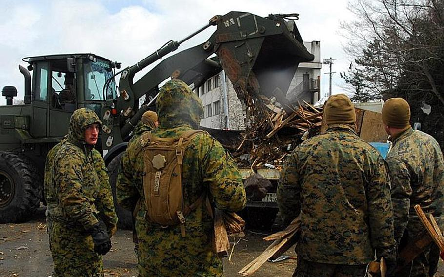 Marines with the 31st Marine Expeditionary Unit use a bulldozer to clean up debris on Oshima Island, Japan, on April 4.