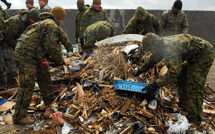 Marines with the 31st Marine Expeditionary Unit clean up debris on Oshima Island, Japan, on April 4 as part of disaster relief efforts.