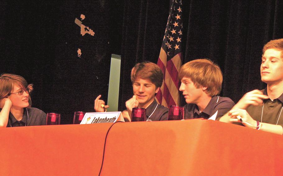 Lakenheath junior Colin McDonnell, second from left, answers a question Wednesday during the championship game of the 2011 All-Europe Academic Bowl in Baumholder, Germany. The Lakenheath team -- from left, Hayley Outlaw, Colin McDonnel, brother Ryan McDonnell and team captain Joe Sullivan -- defeated defending champion Ramstein 40-30 in a 10-question playoff.