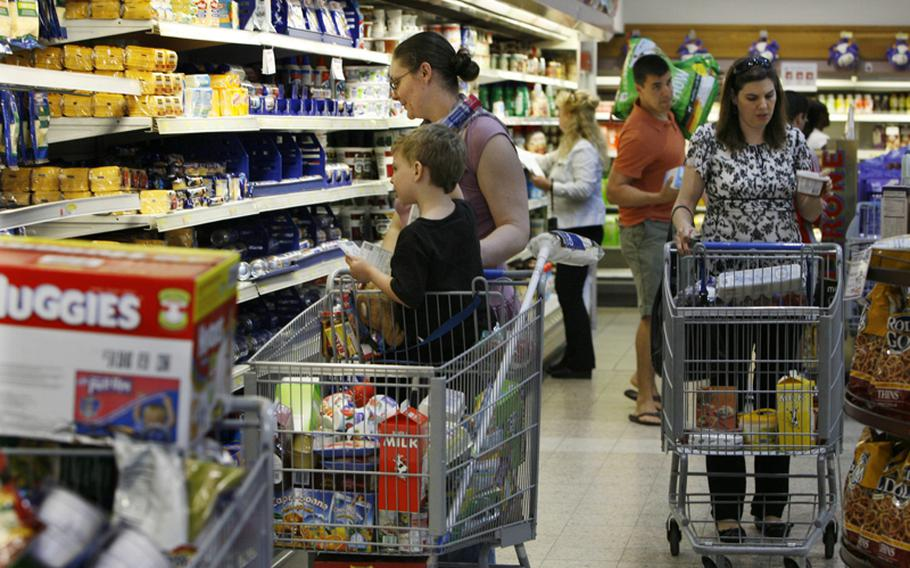 Shopper fill the aisles at the commissary at Ramstein Air Base in Germany on Friday. People were out in force stocking up in case the commissaries closed due to the government shutdown.