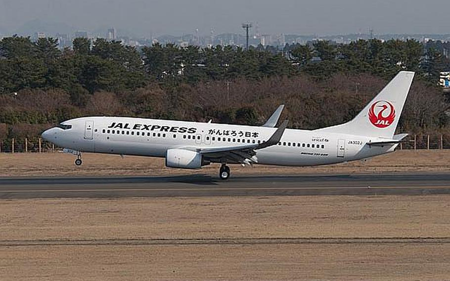 A Japan Airlines Express flight from Haneda Airport lands at Sendai Airport in Sendai, Japan, making it the first commercial flight to the airport since the March 11 tsunami ravaged the airport and region. A message of 'Let's get through this, Japan' was written on the side of the Boeing 737.