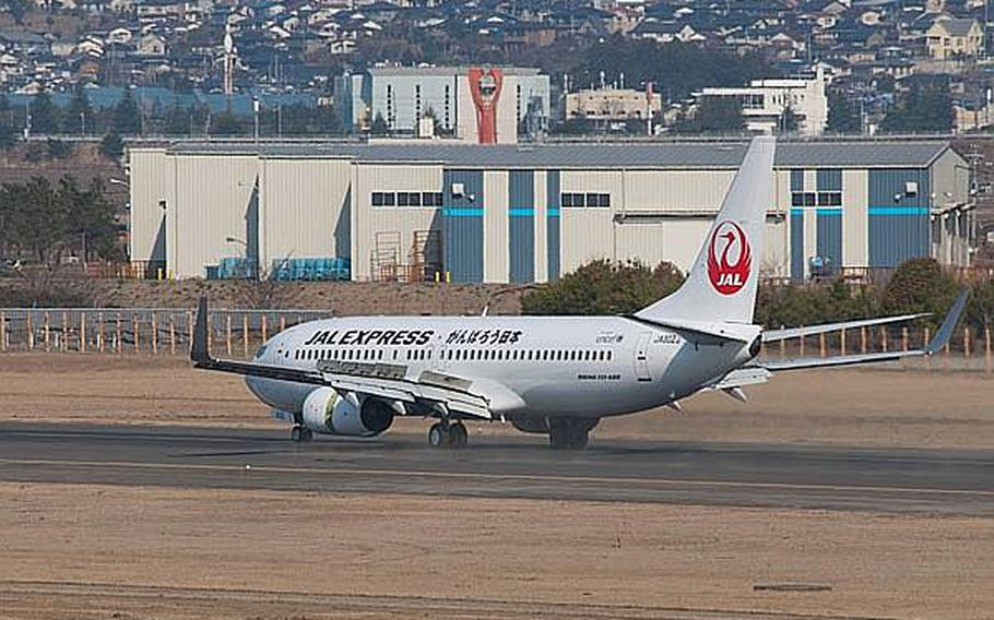 In this file photo, a Japan Airlines Express flight from Haneda Airport lands at Sendai Airport in Sendai, Japan, making it the first commercial flight to the airport since the March 11, 2011, tsunami ravaged the airport and region.