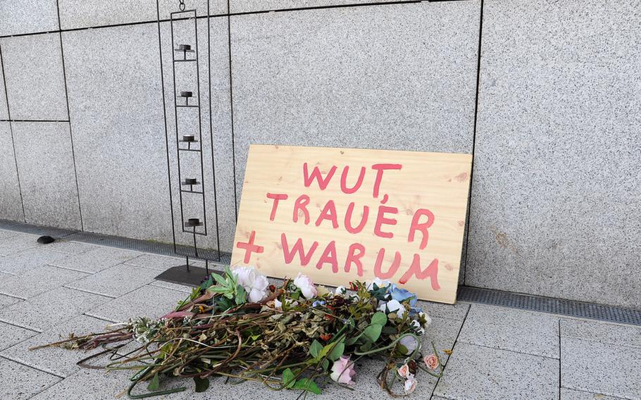 A small memorial set up in the days after the killing of two airmen at Frankfurt International Airport on March 2, remains standing more than six weeks later. It reads rage, sorrow and why. Service members are no longer allowed to wear their uniforms while traveling.  Michael Abrams/Stars and Stripes