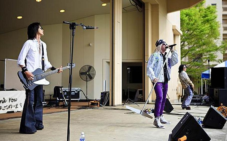 ATs*69 performs their renditions of popular 80s rock at the Sakura Shell on Yokota Air Base Saturday for 'Tomodachi Stock,' a free concert held to raise money through concessions and Red Cross donations for the tsunami victims in northern Japan.