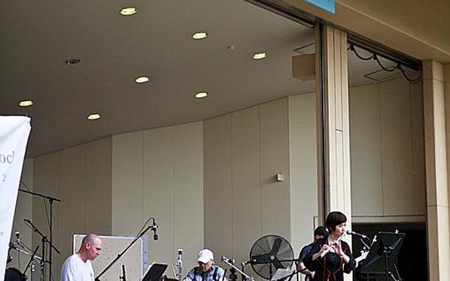 Tr3s, a Latin jazz band, was one of the seven bands performing at 'Tomodachi Stock' Saturday at the Sakura Shell on Yokota Air Base, the site of a free concert to raise money through concessions and Red Cross donations for the tsunami victims in northern Japan.