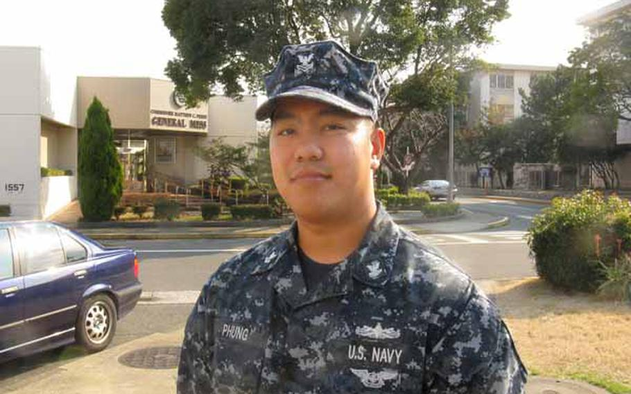 Petty Officer 2nd Class Vu Phung says he hopes his overseas assignment at Yokosuka Naval Base will help his promotion chances. He has an uphill climb -- a combination of overmanning and a precipitous drop in retirements and separations meant that less than 2 percent of sailors in his career field were promoted last fall.
